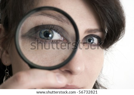 this photo shows a young girl with a magnifying glass - stock photo