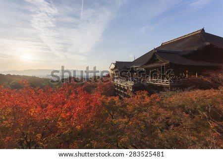 This photo was shot from Kiyomizu Temple in Kyoto, Japan. The maple leaves change to autumn color and the soft sunlight in the evening is so beautiful. - stock photo