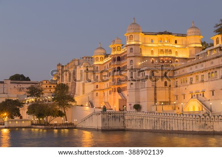This photo was shot from Udaipur city at twilight time. Udaipur city palace was built over a period of nearly 400 years being contributed by several kings of the dynasty.  - stock photo