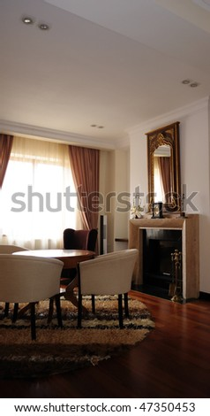 This photograph represent a rich restroom with fireplace in classic style. - stock photo