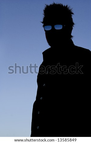 This photographic silhouette has some nice shadow detail. The image is of a creepy but cool looking figure. - stock photo