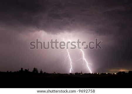This picture has taken in a big storm, huge thunders and lightens were in this field, next to a little town. - stock photo