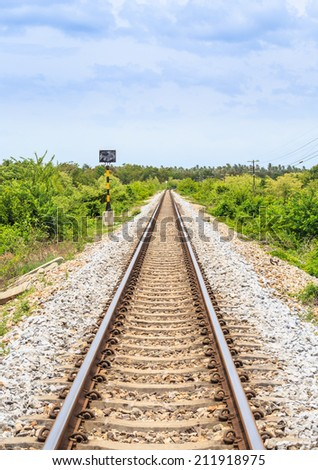 This picture of the long and straight railroad track was taken in the south of Thailand. - stock photo