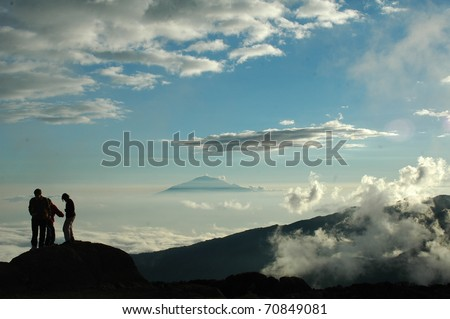 This picture was taken with our back to Mount Kilimanjaro while climbing the machame route. The mountain in the background is Mount Meru - stock photo