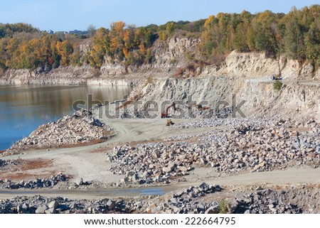 This quarry from which extract granite, Loader and other machines work.  - stock photo