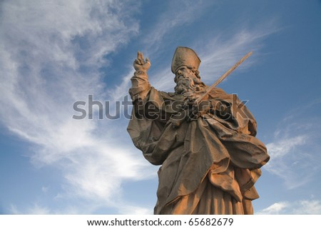 "This sculpture of St. Kilian is one of many others positioned onto the ""Alte Mainbruecke"" - stock photo"
