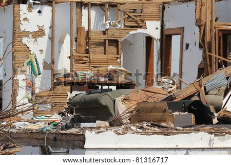 This severely damaged home is just one of thousands of homes destroyed in the 2011 tornado outbreaks throughout the US. - stock photo