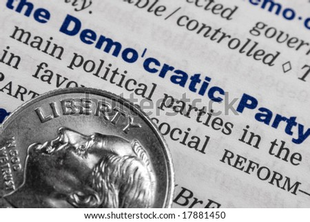 This shots shows a page of a dictionary, where the term 'the demoratic party' is explained... Also there is a dime brougth into the context - stock photo