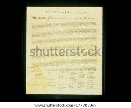 This shows the original Declaration of Independence in its entirety written on its now faded parchment paper. - stock photo