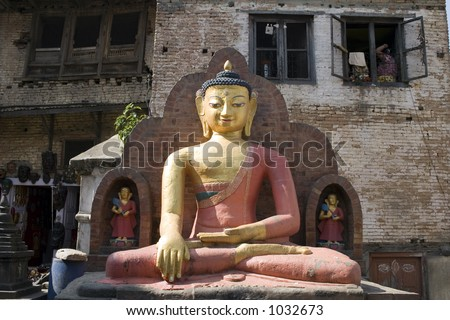 This statue of Buddha is located at the Swayambhunath Temple in Kathmandu, Nepal. This Buddha is the lord of Stillness and resists temptation. - stock photo