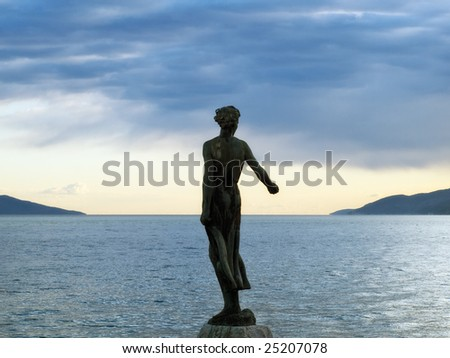 This statue on the adriatic coast is a symbol of touristic town Opatija. - stock photo