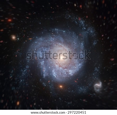 This striking spiral galaxy is home to a supernova, SN 2002fk. Astronomers are using that supernova to measure the expansion rate of the universe. Elements of this image furnished by NASA. - stock photo
