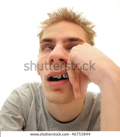This student is bored out of his mind listening to the dull lecture that is being presented. Isolated on white background with room for your text. - stock photo