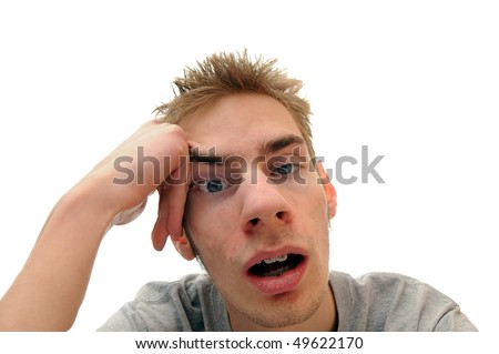 This student is bored out of his mind listening to the dull lecture that is being presented. Isolated on white background with room for your text - stock photo