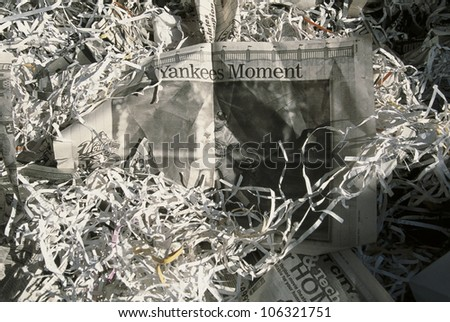 This was at the 1998 Ticker Tape Parade for the New York Yankees. It took place in the Canyon of Heroes and 3.5 million people attended. These are the newspaper headlines and confetti from the parade.