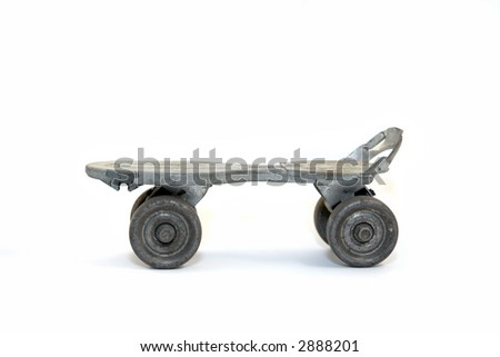 This was my roller skate about 45+ years ago.  I found it in my mother's attic. Looks like it lost its toe bracket. - stock photo