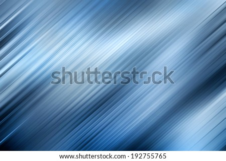 This wavy, diagonal blue patterned background image has cool, neutral tones with highlighting to support text placement - stock photo