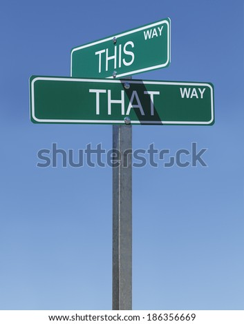 This Way and That Way Street Signs with Blue Sky Background.