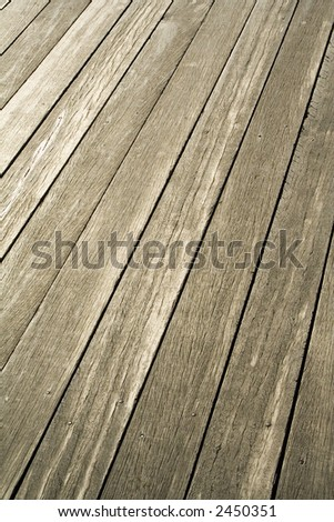 This weathered decking is the top of a Pier located along the waterfront in Brooklyn facing Lower Manhattan.