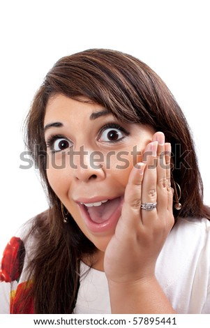 This young hispanic woman looks totally and completely surprised. She just found out something that was absolutely unbelievable. - stock photo