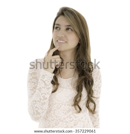 This young lady have a finger on her chin she is looking up an thinking. - stock photo