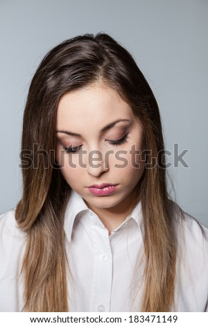 This young woman is going through some tough times - stock photo