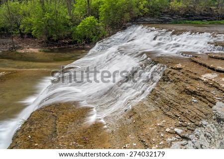 Thistlethwaite falls is a waterfall that cascades down rocky ledges in Richmond, Indiana. - stock photo