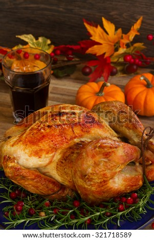 Thnaksgiving dish - turkey with pumpkins and glass of wine - stock photo