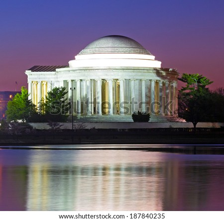 Thomas Jefferson Memorial at predawn in spring. Jefferson Memorial reflection in Tidal Basin waters.