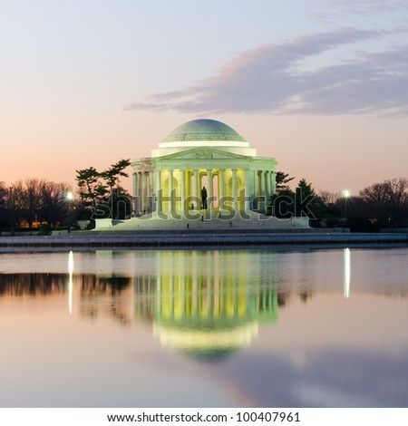 Thomas Jefferson Memorial silhouette at sunrise with mirror reflection on water, Washington DC United States - stock photo