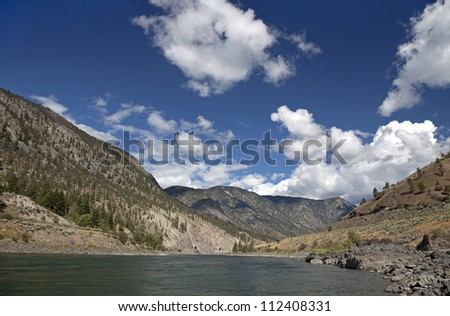 Thompson River in mountains - stock photo