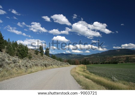 Thompson River Valley in Thompson-Nicola district of British Columbia (Canada) - beautiful landscape with gravel road - stock photo