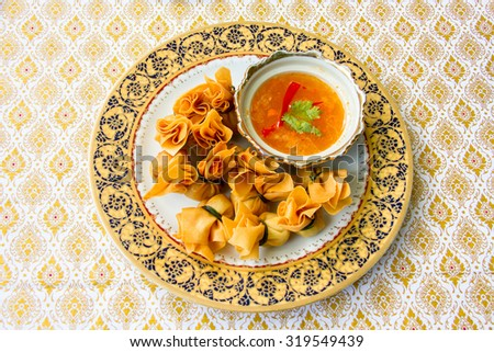 Thong Thung Traditional Thai Halal Food served on Traditional Thai Plate with hot and spicy source - stock photo