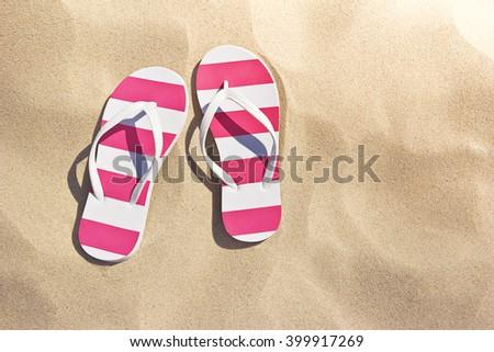 thongs on the beach - stock photo