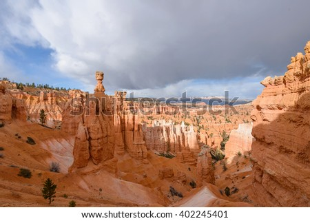 Thor's Hammer - Spring storm clouds moving over towering Thor' Hammer and valley of hoodoo sandstone formations in Bryce Canyon National Park, Utah, USA. - stock photo
