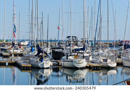 THORNBURY, ONTARIO - JUNE 9, 2014: Sailboats in early morning at the Thornbury Harbour on the southern shore of Georgian Bay.  - stock photo
