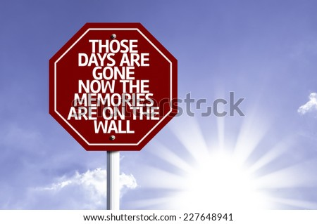 Those Days Are Gone Now The Memories Are On The Wall written on red road sign with a sky on background - stock photo