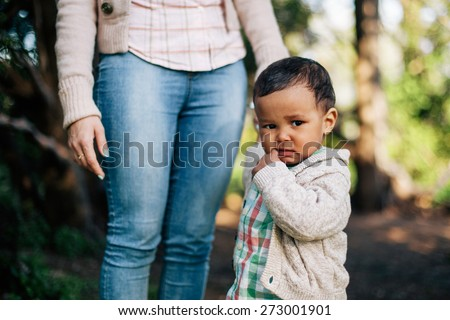 Thoughtful African American Boy holding his mother hand. - stock photo