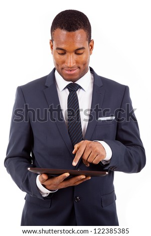 Thoughtful african american young businessman with tablet computer, isolated on white - stock photo