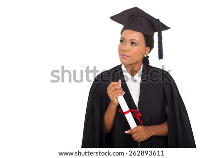 thoughtful african female graduate looking at empty space - stock photo
