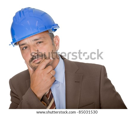 Thoughtful architect wearing a hard hat - stock photo