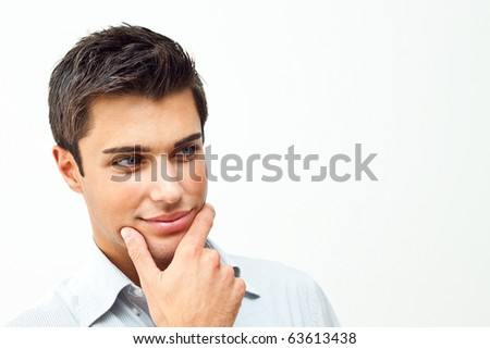 Thoughtful attractive man - stock photo