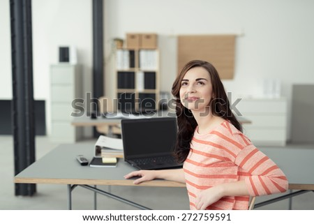 Thoughtful Attractive Young Girl Sitting at her Table Laptop Computer and Notes While Looking Up and Thinking of Something. - stock photo