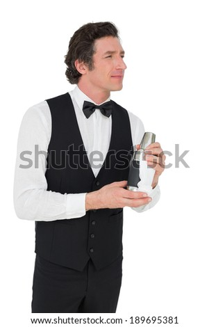 Thoughtful bartender holding cocktail shaker isolated over white background - stock photo