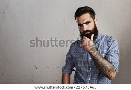 Thoughtful bearded man - stock photo