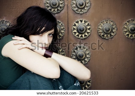 Thoughtful beautiful woman over antique background. - stock photo