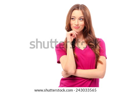 Thoughtful beauty. Beautiful young woman holding hand on chin and looking away while standing isolated on white - stock photo