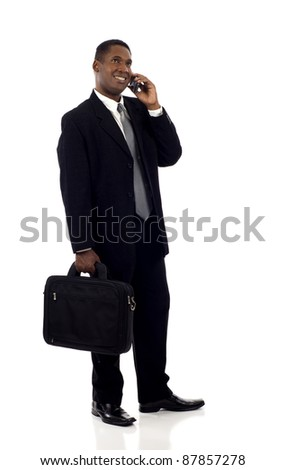 Thoughtful black business looking up at copyspace while talking on the mobile phone isolated over white background - stock photo