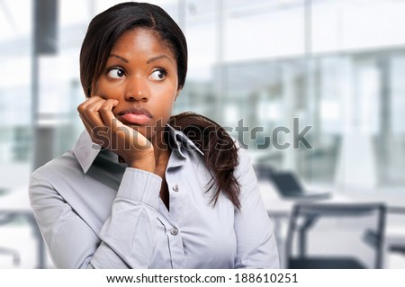 Thoughtful black businesswoman in the office - stock photo