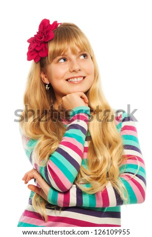 Thoughtful blond girl smiling dreaming and thinking about something - stock photo